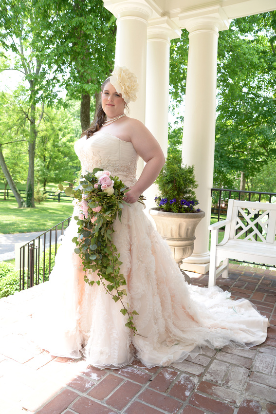 David and Sarah Smiley at the Storybook Inn at Versailles KY, May 2015.  Photographs by Bart Massey Photography.  Outdoor wedding.  Victorian style wedding with a tea and book theme.