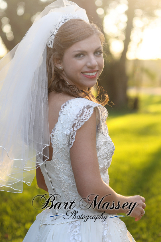 Bride at the reception in the warm evening sun